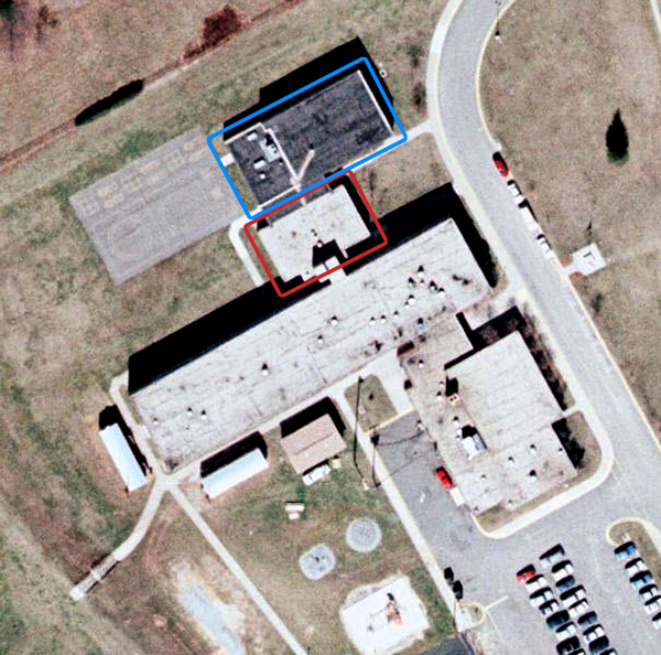 Aerial photograph of Clermont Elementary School taken in 1990. Sections of the school are highlighted as described in the caption.