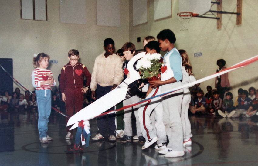 Photograph of a ribbon cutting ceremony in Clermont's gymnasium.