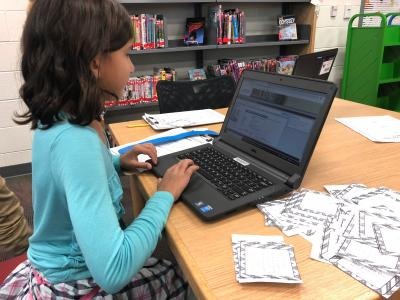 students finding books with a library catalog